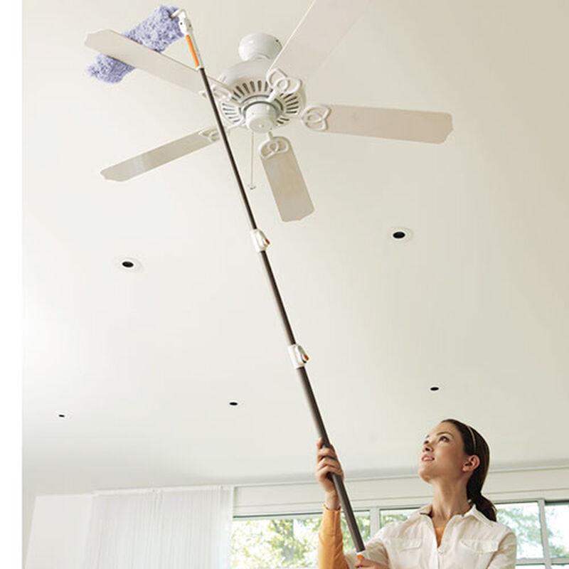 Woman dusting ceiling fan